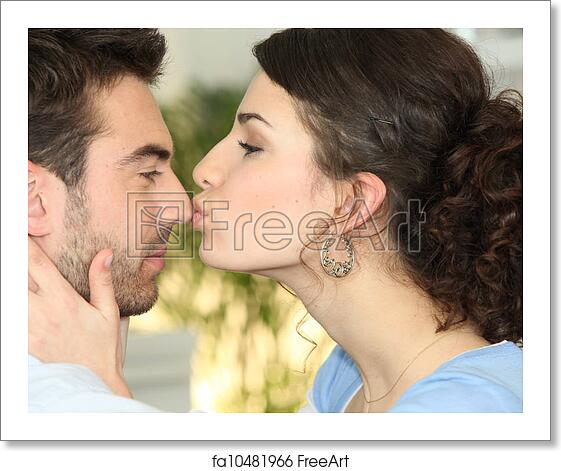 a woman kissing a man