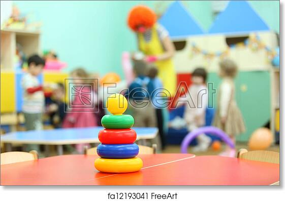 Free Art Print Of Colorful Pyramid Toy Stand At Table In Kindergarten Children Play