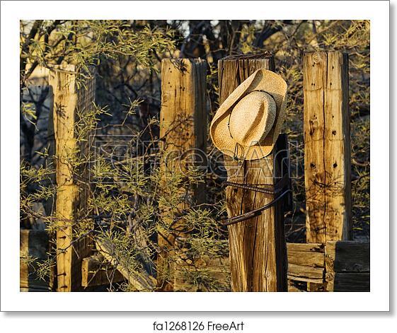 c1b3e81d9c5 Free art print of Cowboy Hat on a Post. Straw cowboy hat hanging on ...