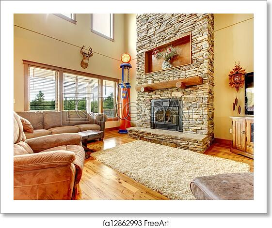 Free Art Print Of Living Room With High Ceiling Stone Fireplace And Leather Sofa
