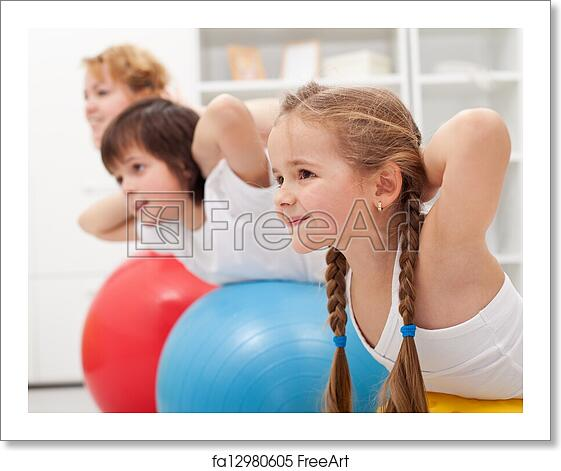 Free Art Print Of Kids And Woman Doing Exercises With Balls Kids And Woman Doing Gymnastic Exercises With Balls Stretching Their Back Freeart Fa12980605