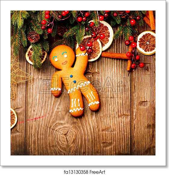 Free Art Print Of Christmas Holiday Background Gingerbread Man Over Wood