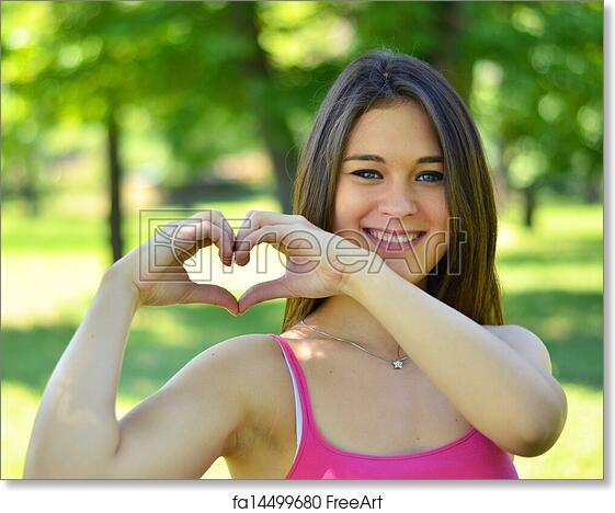 Free Art Print Of Cute Teen Girl Making Heart Shape With Her Hands Outdoors