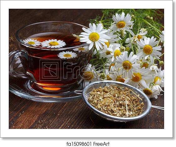 Free art print of Chamomile tea and dried flowers on wooden table