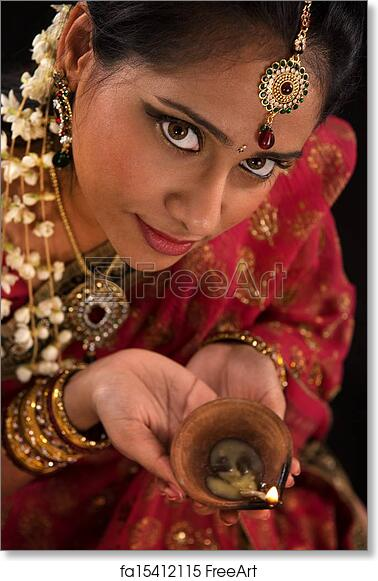 4a0a3e93e5 Free art print of Diwali Indian female with oil lamp. Close up portrait of  beautiful young Indian woman in traditional sari dress holding a diwali oil  lamp ...