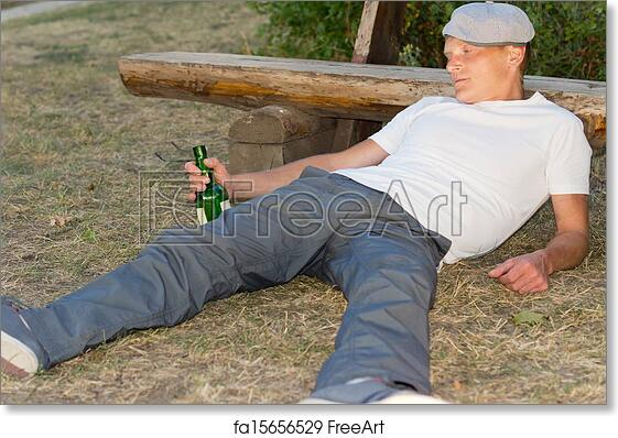 Free Art Print Of Drunk Man Fallen Down On The Ground In The Park