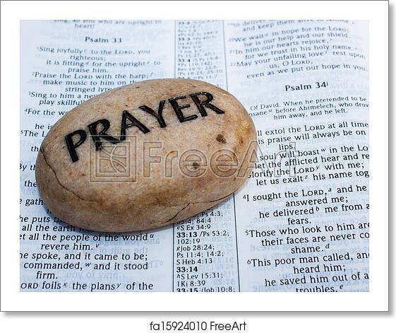 Free art print of Prayer rock on an open bible