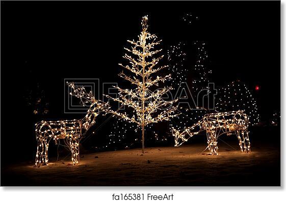 free art print of christmas yard lights lighted reindeer and christmas tree yard art in the snow freeart fa165381