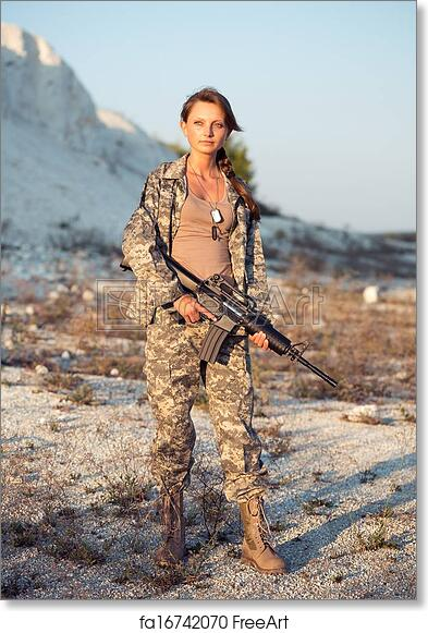 Free art print of Young beautiful female soldier dressed in a camouflage  with a gun in the location
