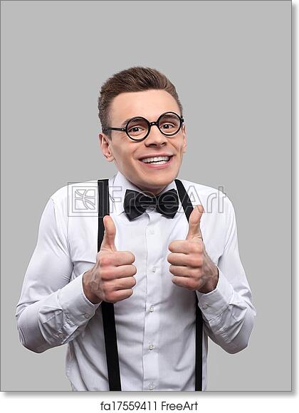 1583ba0329e3 Portrait of young nerd man in bow tie and suspenders looking at camera and  gesturing while standing against grey background