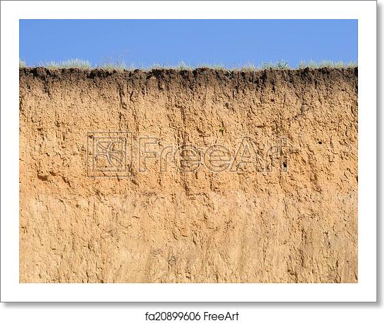 Free art print of Cut of soil with different layers, grass and sky