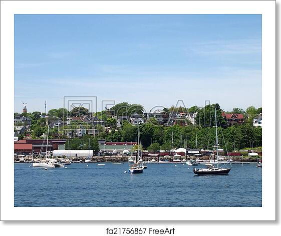 Free art print of Portland Maine Coastline with boats in the water, homes  on the s