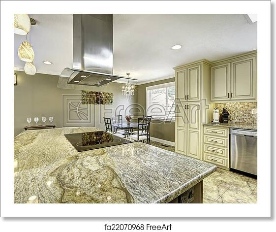 Free art print of Beautiful kitchen island with granite top, built-in stove  and ho