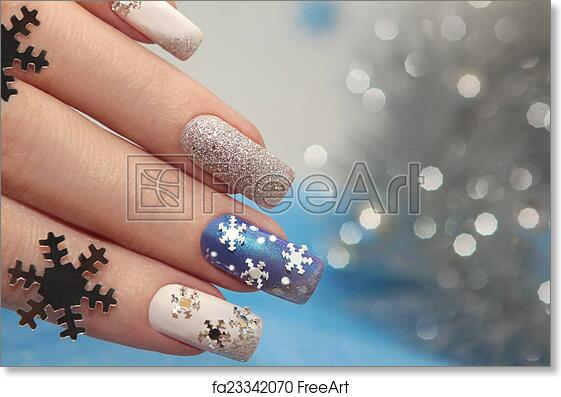 Free art print of Manicure with snowflakes. Manicure with snowflakes on your nails with colored lacquers on a rectangular shaped nails.