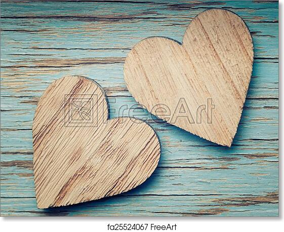 Free Art Print Of Two Wooden Hearts Placed Nicely On A Turquoise Vintage Wood Back