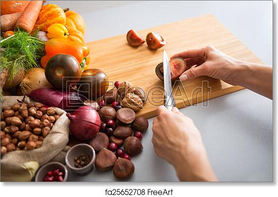 Free art print of Closeup on young housewife cutting cherokee purple tomato
