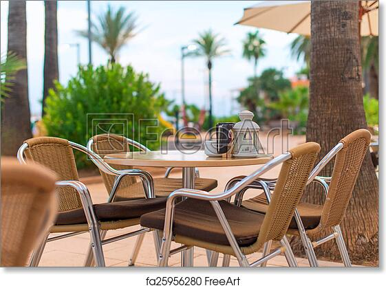 Free Art Print Of Mediterranean Cafe Terrace Exterior With Chairs.