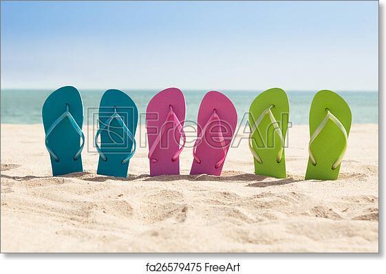1ce9404c1d7f Free art print of Pairs Of Flip-flops On Beach. Colorful Three Pairs Of Flip -flops On Beach