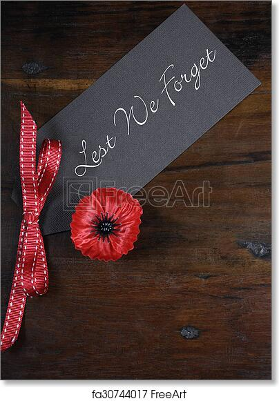Free art print of Lest We Forget, Red Flanders Poppy Lapel Pin Badge for  November 11, Remembrance Day appeal, on dark recycled wood background