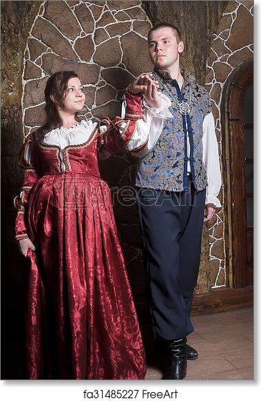386bdd204b39d Free art print of Attractive couple in retro dresses dance. Beautiful  couple woman and man in medieval clothes in the room | FreeArt | fa31485227