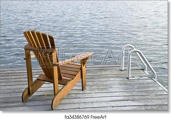 Free Art Print Of One Muskoka Chair By The Lake