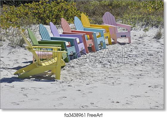 Free art print of Row of Colorful Adirondack Chairs on the Beach