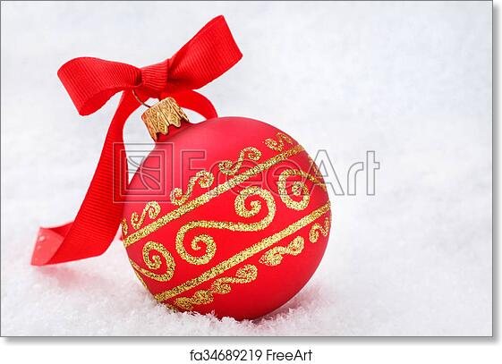 free art print of red christmas ball with ribbon in the snow