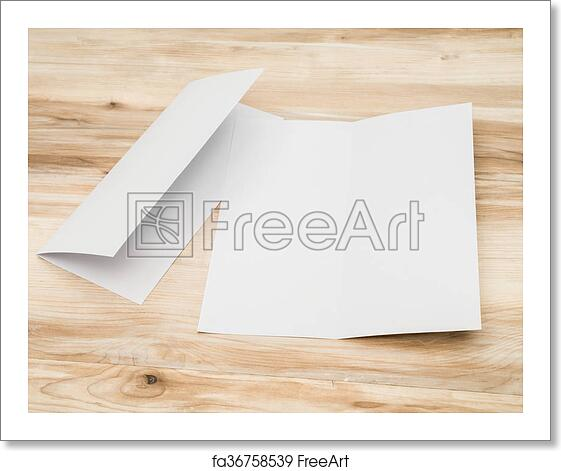 free art print of bifold white template paper on wood texture