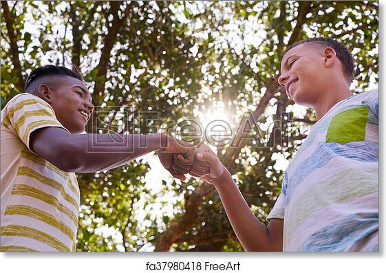 Free art print of African And Caucasian Boys Joining Hands Against Racism