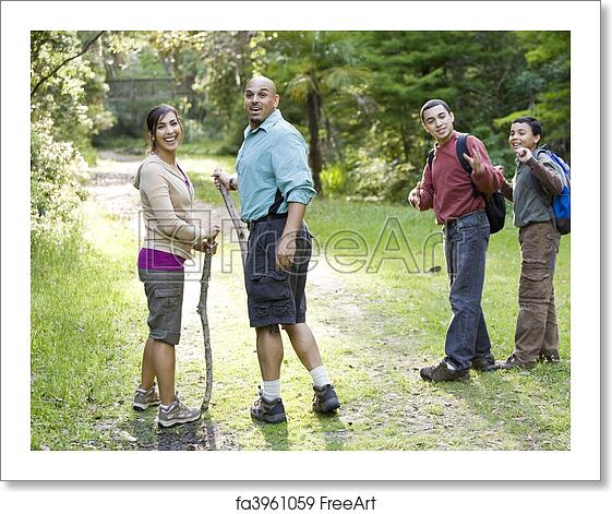 Free Art Print Of Hispanic Family Hiking In Woods On Trail