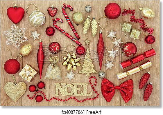 Free art print of Red and Gold Christmas Decorations. Red and gold christmas tree baubles and decorations with noel sign forming an abstract background over ...