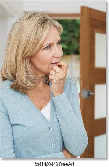 Free Art Print Of Sad Mature Woman Suffering From Agoraphobia Looking Out Of Open Door