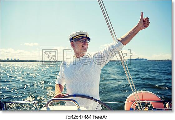 6d4e2452b56cc Free art print of Senior man at helm on boat or yacht sailing in sea ...