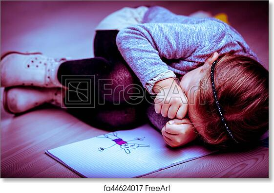 Free Art Print Of Upset Little Girl Curled Up Next To Her Drawing