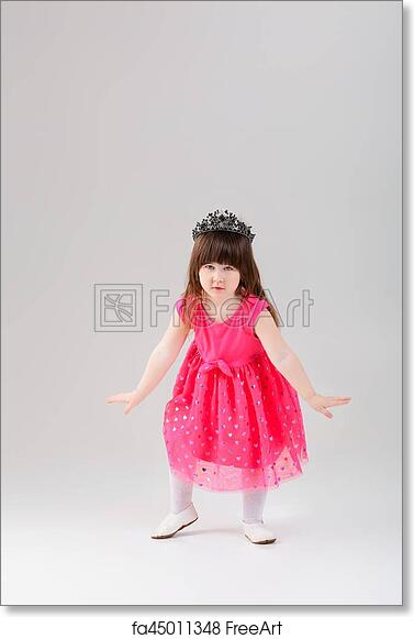 bffca6fe1c8c Beautiful little brunette girl in pink Princess dress with a crown trying  to curtsy on a gray background. cute baby