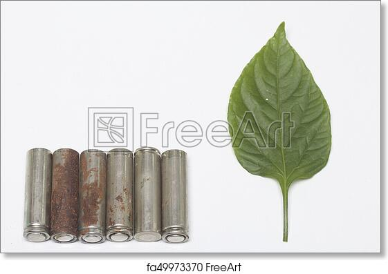 free art print of waste batteries of different types are scattered