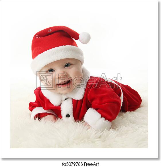 c68b45335f6 Happy Smiling baby lying on tummy wearing a red and white Christmas Santa  hat and suit
