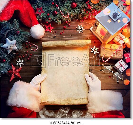 Free Art Print Of Santa Claus Desk Reading Wish List With Ornament