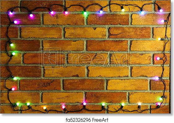 christmas background with lights and free text space christmas lights border glowing colorful christmas lights on brick wall background new year