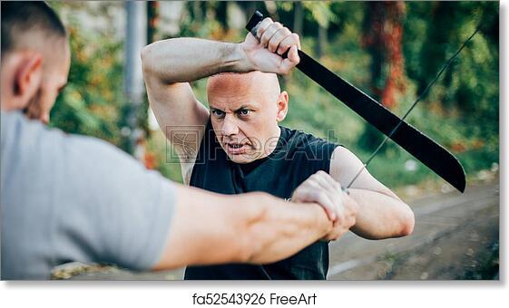 Free Art Print Of Martial Arts Instructor Demonstrates Machete Fighting Long Knife Weapon Training Freeart Fa52543926