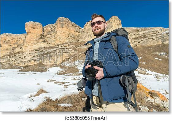 Free art print of portrait a bearded hipster photographer with a free art print of portrait a bearded hipster photographer with a backpack and wearing sunglasses with a large backpack on his shoulders stands with a dslr voltagebd Image collections