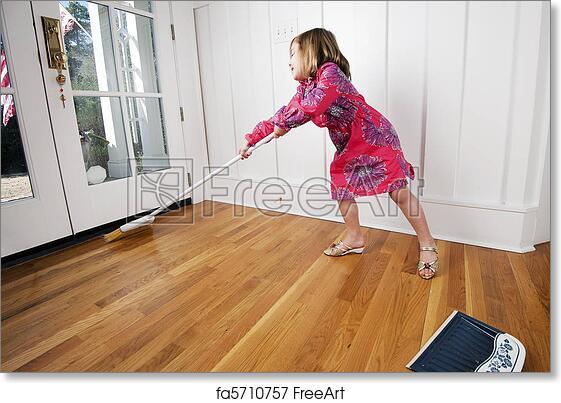 Free Art Print Of Young Girl Reaching To Sweep Wood Floor By Door