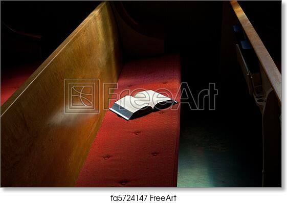 free art print of open bible lying on church pew in narrow sunlight band - Church Pew