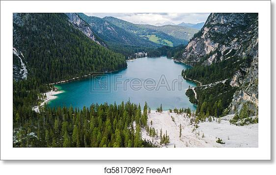 Free art print of Aerial view of the crystal clear lake Lago Di Braies with  house