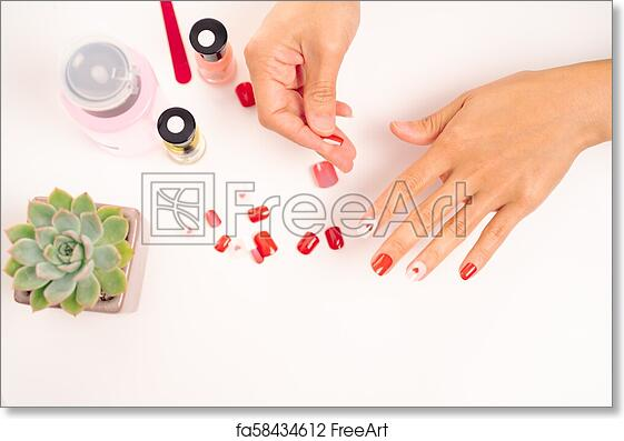 Free Art Print Of Women Manicure And Attaches A Nail Shape During