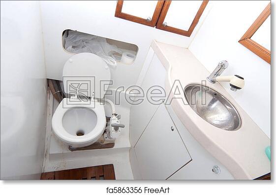 Free art print of Latrine and shower on sailing boat. Latrine and shower on sailing boat with toilet paper | FreeArt | fa5863356