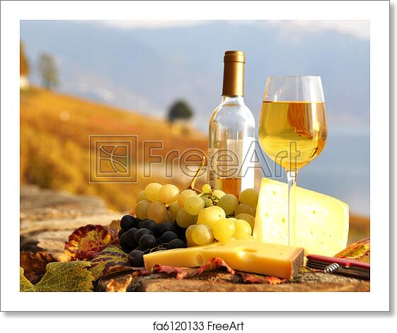 Free art print of Glass of white wine and chesse on the terrace vineyard in  Lavaux region, Switzerland
