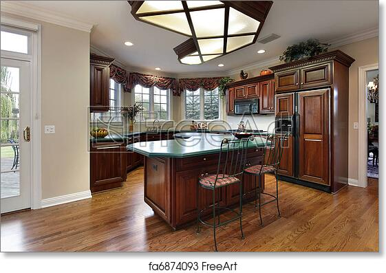 Free Art Print Of Kitchen With Green Island Counter. Kitchen With Dark Wood  Cabinets And Green Island Counter | FreeArt | Fa6874093
