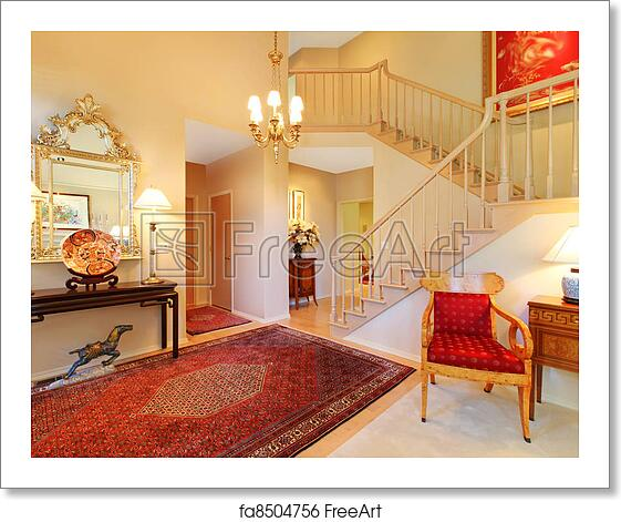 Free art print of Luxury entrance living room with red rug, staircase.