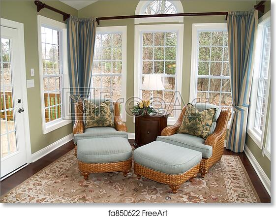 Free Art Print Of Bright Sunroom. Two Comfortable Rattan Or Wicker Chairs  In A Nicely Decorated Luxury Sunroom | FreeArt | Fa850622
